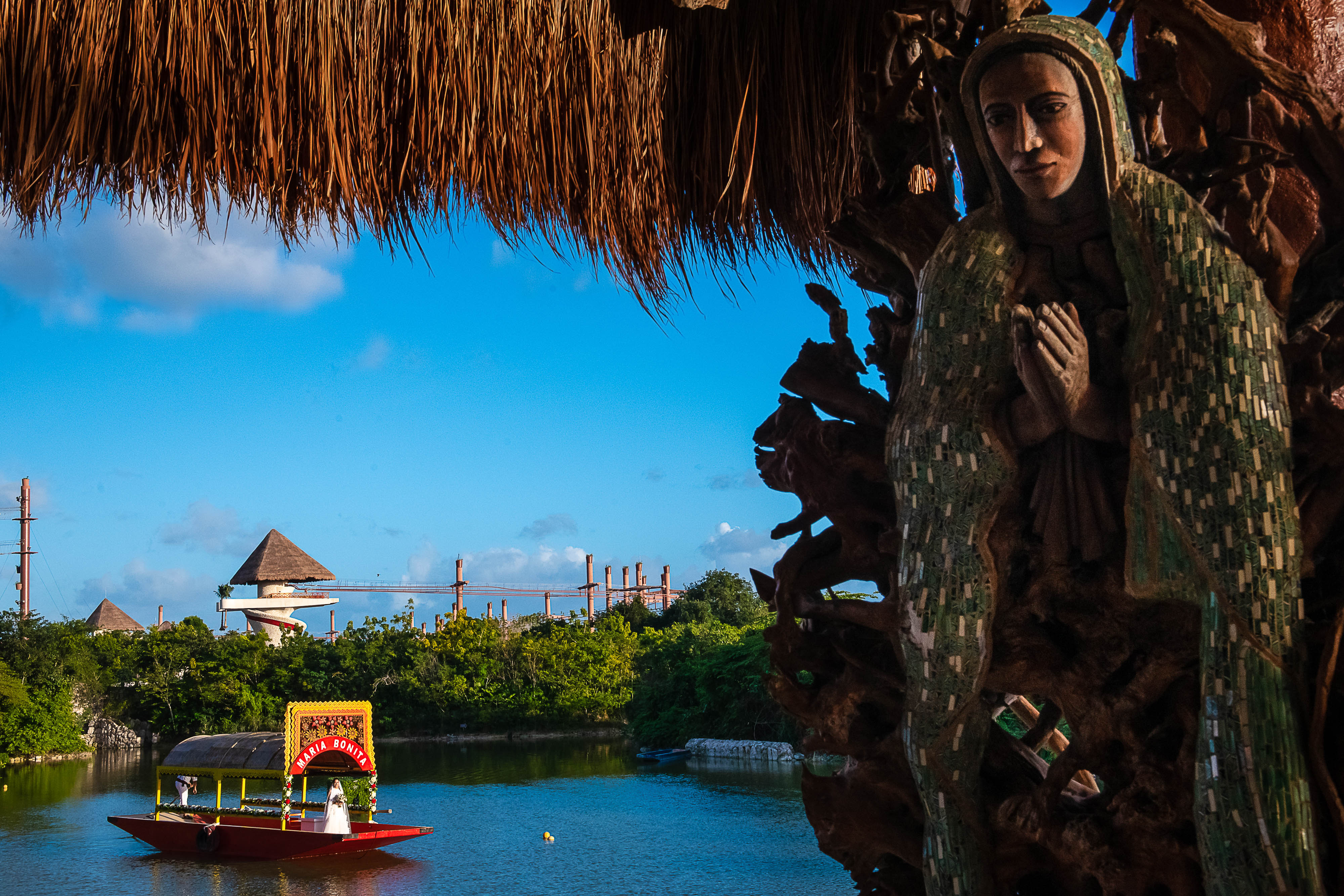 the bride with a beautiful view crossing the lake in a mexican trajinera to meet him with her future husband at xoximilco chapel cancun