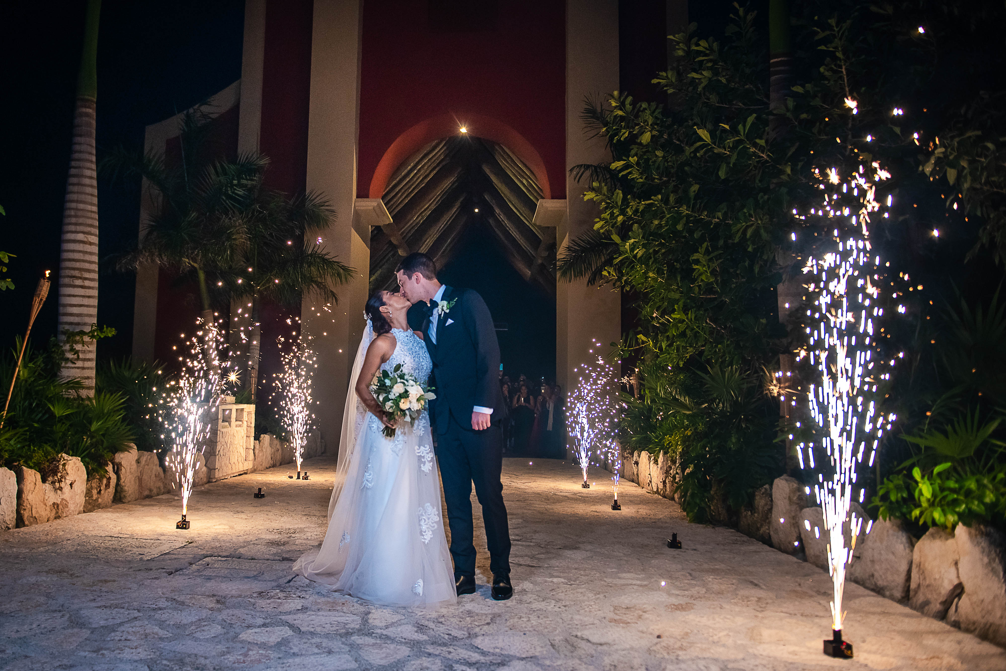 sparkles at the end of the ceremony celebrating their marriage in the xoximilco chapel in cancun