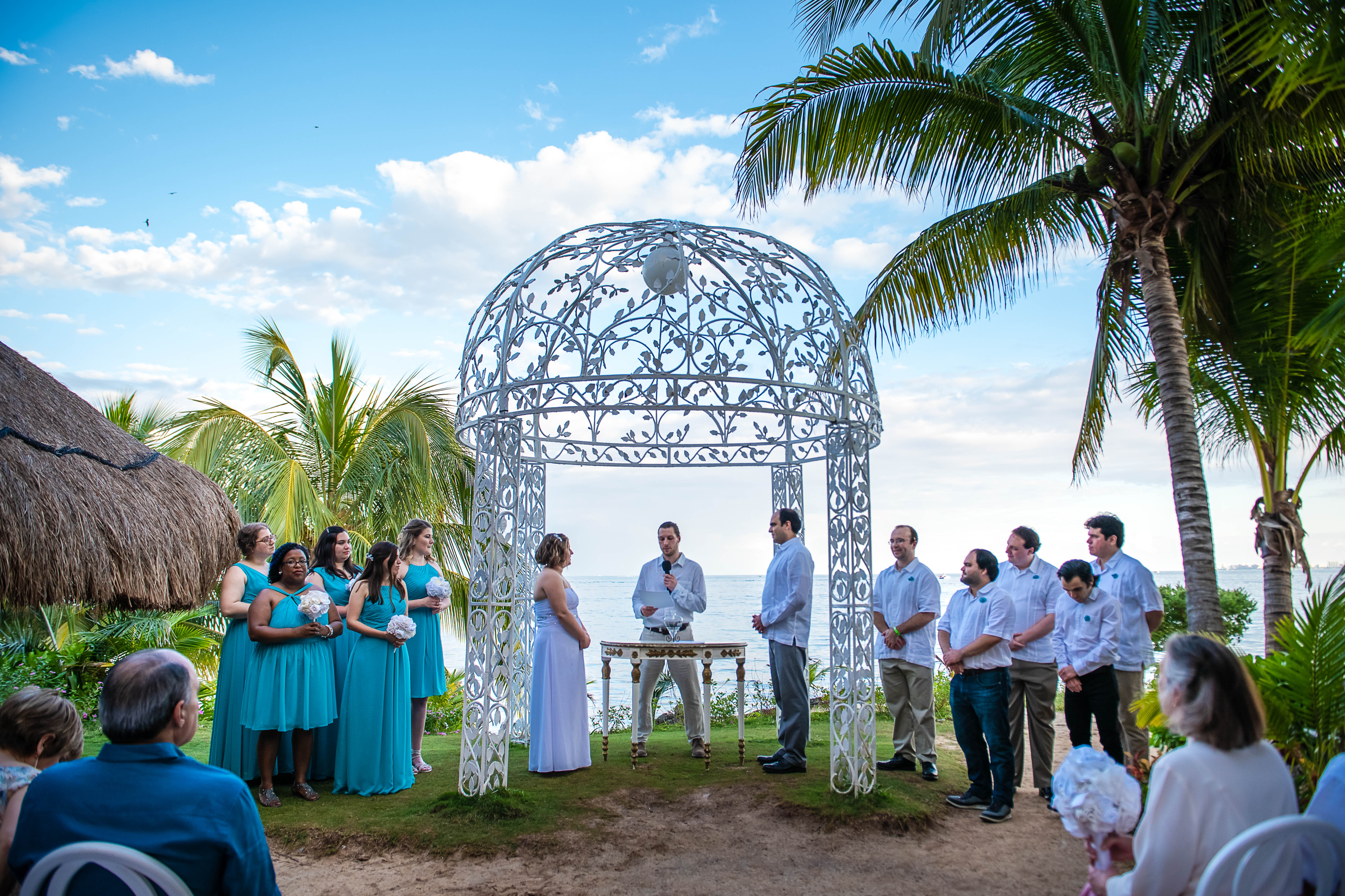 bride & groom during their ceremony looking to each other in Ocean Events at Puerto Juarez Quintana Roo Mexico