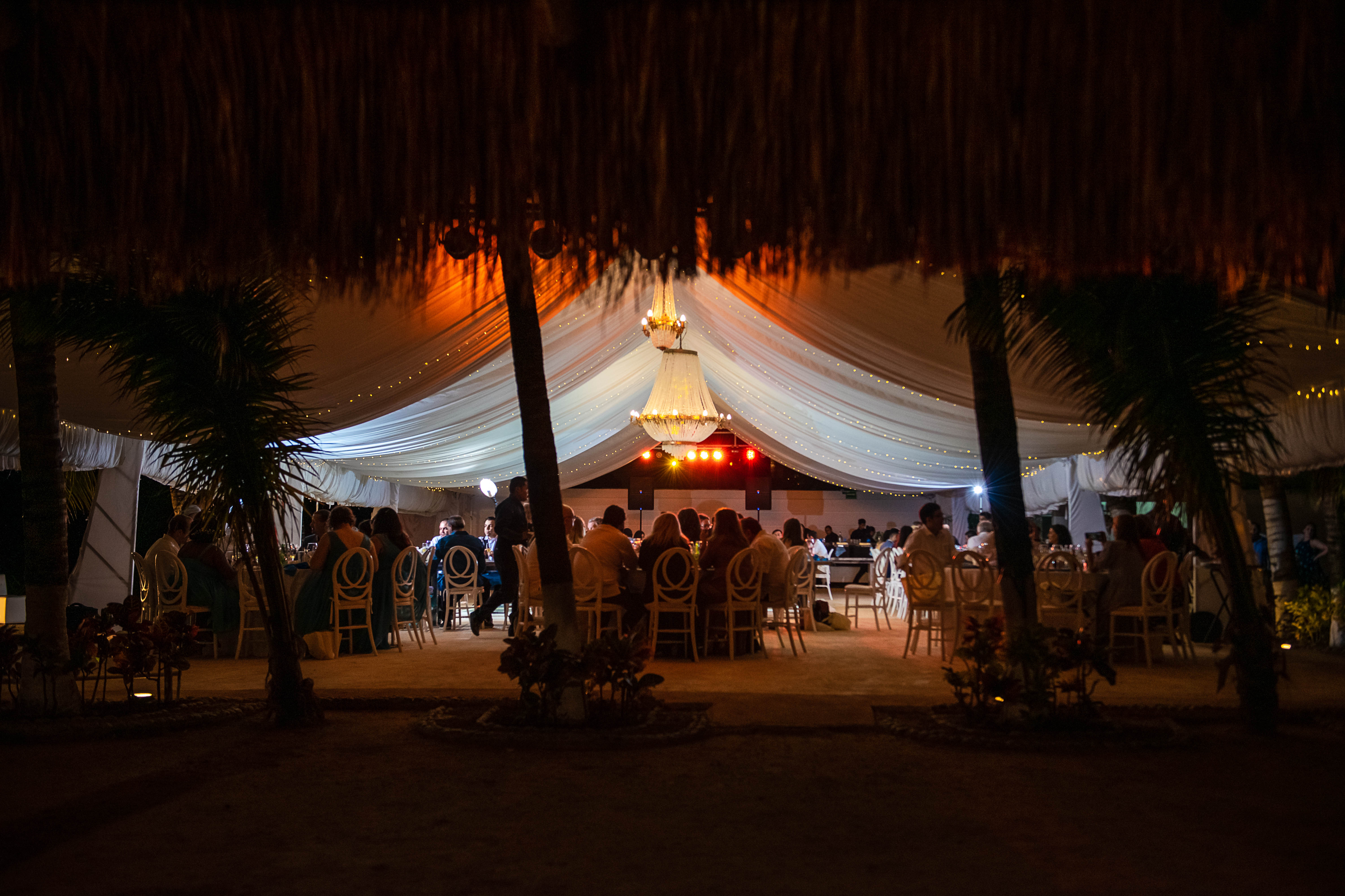 the set up and candles at the palapa during the dinner in te wedding in Ocean Events Cancun