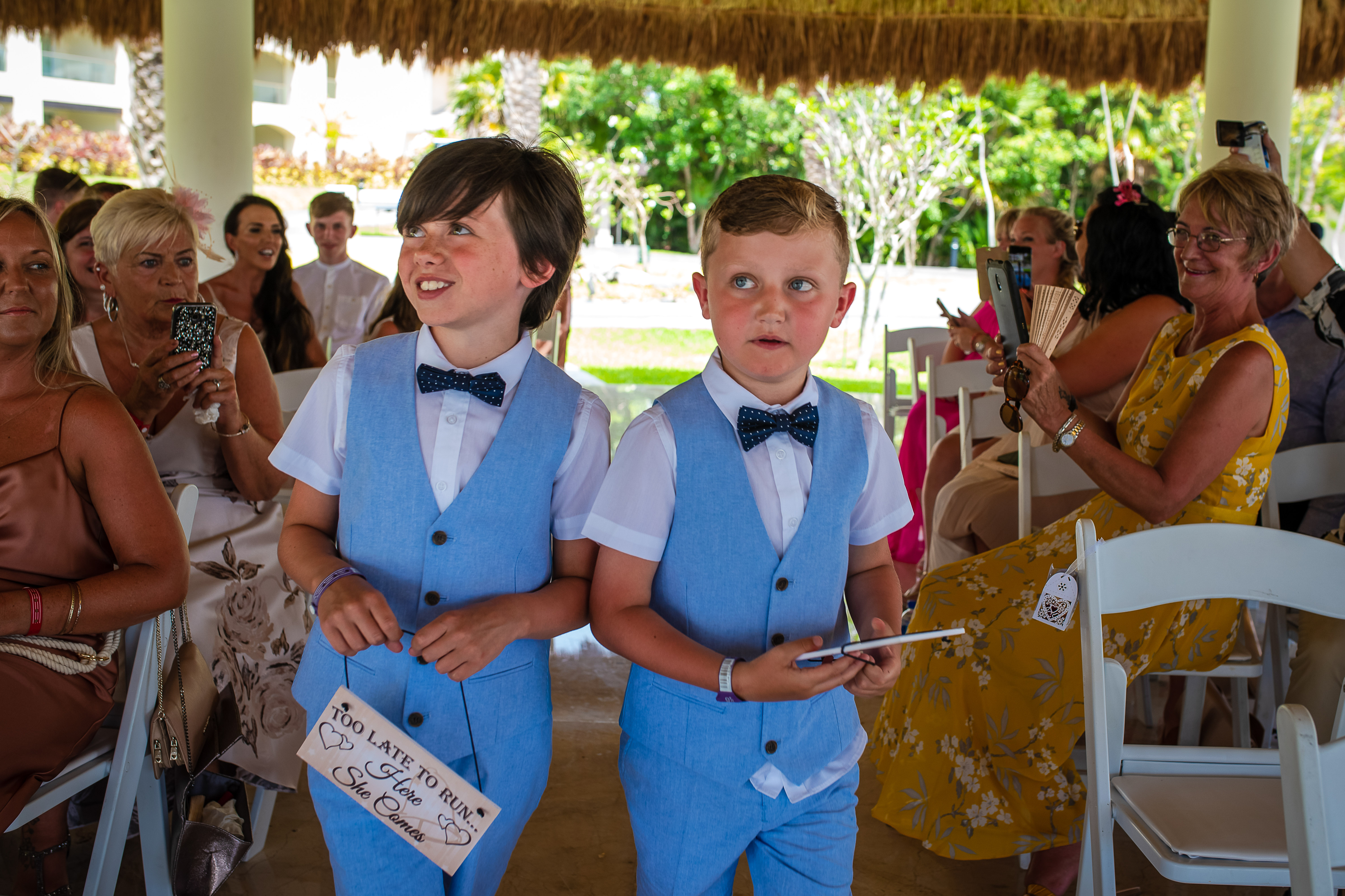 children with signs walking towards groom last chance to run warning