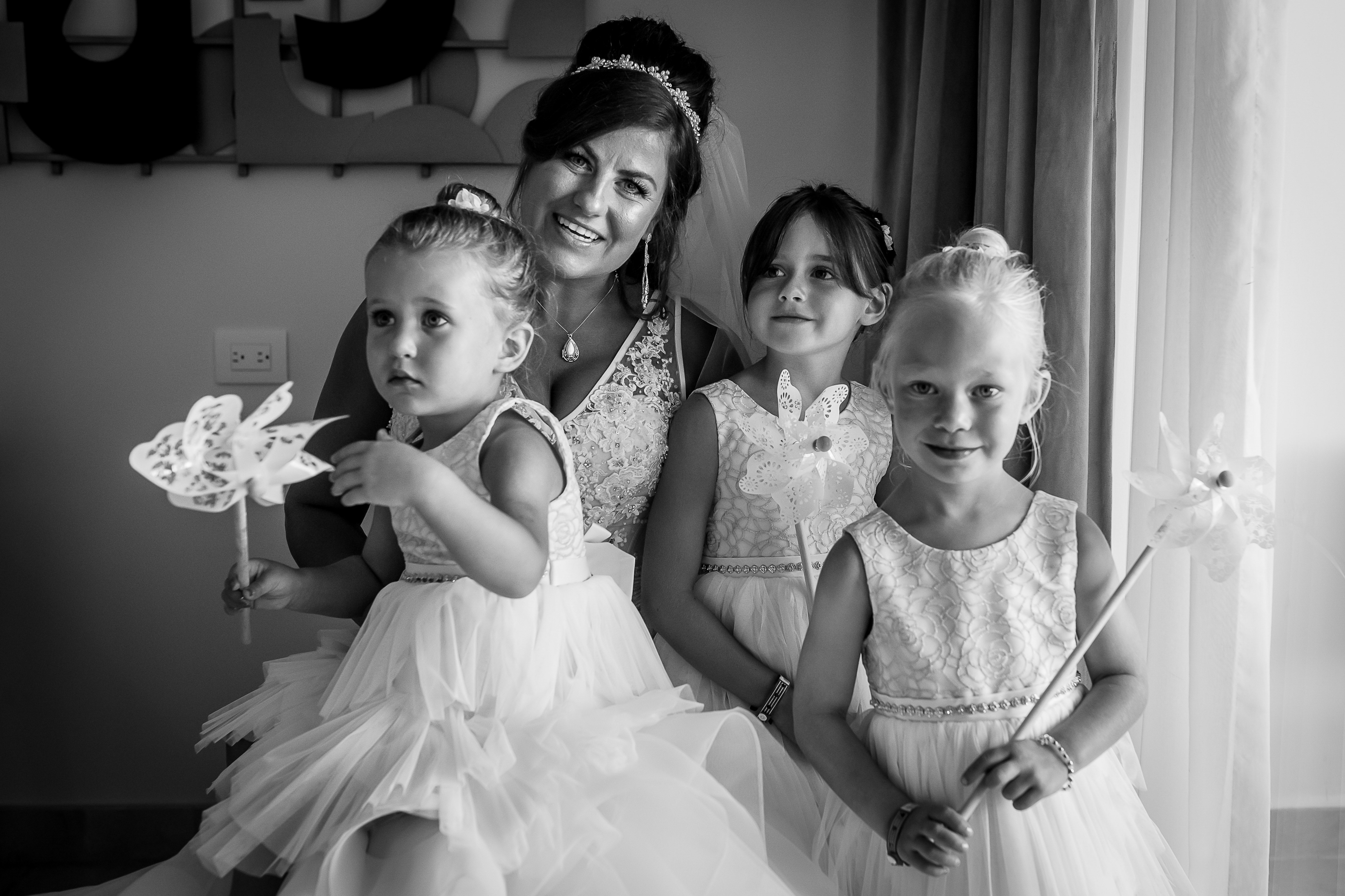 the bride posing with the flower girls in the grand at moon palace resort